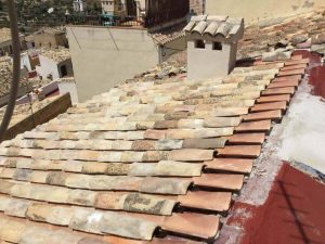 Roof with new and old tiles