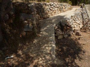 road between stone margins under construction